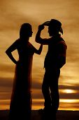 Cowboy Couple Stand Silhouette His Hand On Hat