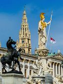the parliament in vienna, austria. with the statue of