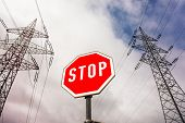 a poles of a power line and a stop sign. symbolic photo for phasing out nuclear power