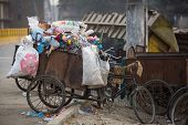 KATHMANDU, NEPAL - DEC 19, 2013: Pile of domestic garbage at landfills. Only 35% population of Nepal