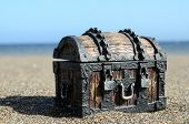 foto of chest  - Old Classic Wood and Iron Treasure Chest on the Beach - JPG