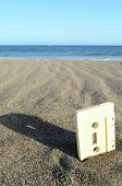 Ancient Retro Musicassette on the Sand