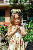 Cute Little Girl With Flowers Chaplet