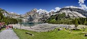 OESCHINEN LAKE, KANDERSTEG, SWITZERLAND - JUNE 8, 2014 - Since 2007 the Oeschinen lake is part of th