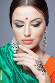 fashion portrait of beautiful woman in indian sari