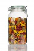 Storage Jar With Colorful Pasta Noodles With Real Reflection