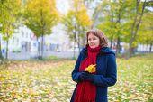 Girl Walking In A Fall Park