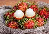 Asian Fruit Peeled Rambutan And Rambutan On Sack From Thailand