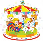 picture of amusement park rides  - Children riding on a funny carousel in an amusing park - JPG