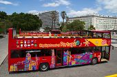 LISBON, PORTUGAL - MAY 26, 2014: A City Sightseeing bus in Lisbon. City Sightseeing operates in 100