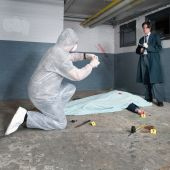stock photo of crime scene  - Forensic expert bagging evidence at a crime scene whilst a police inspector is taking notes around the corpse of a murdered businessman - JPG