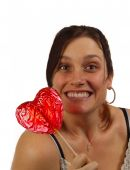 Young Woman Happy To Have Received A Heart Shaped Lollipop For Valentine's Day