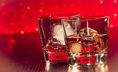 Whiskey Glass With Ice In Front Of Empty Whiskey Glass