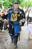 MUSKOGEE, OK - MAY 24: A man dressed as a royal knight stops to talk during the Oklahoma 19th annual Renaissance Festival on May 24, 2014 at the Castle of Muskogee in Muskogee, OK.