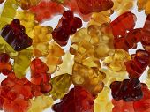 picture of jelly babies sugar  - some colorful gummy bears in light back - JPG