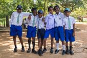 SIGIRIYA, SRI LANKA - 28 FEBRUARY, 2014: Group of unidentified school students posing in garden comp
