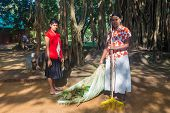 SIGIRIYA, SRI LANKA - 28 FEBRUARY, 2014: Two women cleaning tha path in Sigiriya garden complex, UNE