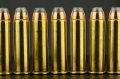 stock photo of hollow point  - 357 jacketed hollow point pistol ammunition in a row - JPG