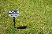 stock photo of manicured lawn  - Keep Off The Grass Notice on a well manicured lawn