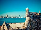 Havana. View of the old city through a bay from Morro's fortresswith a retro effect
