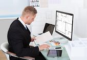 Businessman Analyzing A Spreadsheet Online Checking