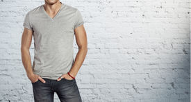 stock photo of apparel  - Young handsome man wearing blank grey t - JPG