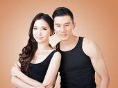 Young Asian sport couple, closeup portrait.