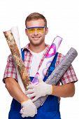 Smiling repairman with wallpaper