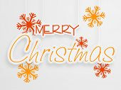 Merry Christmas celebration poster or banner decorated with stylish hanging text and snowflakes on grey background.
