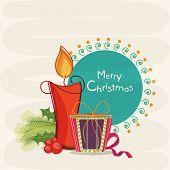 Merry Christmas celebrations greeting card decorated with stylish text, illuminated candle and gift box on stylish background.