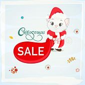 Beautiful Sale poster or banner for Christmas with cute cat in Santa dress on stylish sky blue background.