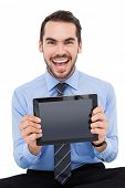 Happy businessman showing his tablet pc on white background