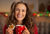 Portrait Of Happy Young Woman With Cup Of Hot Chocolate And Chri