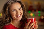 Portrait Of Smiling Young Woman With Cup Of Hot Chocolate In Chr