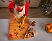 Young Housewife Chopping Walnuts