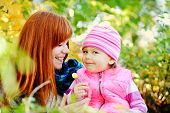 stock photo of sisters  - teen sister and baby sister having fun outdoors in fall time - JPG