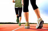 Women Running On Tracks
