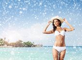 Young and beautiful girl on a beach in exotic country. Seasonal winter vacations concept. .