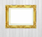 Golden Frame On Wood Wall Background