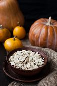 Bowl With Toasted Pumpkin Seeds And Wooden Spoon