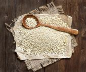 picture of quinoa  - Organic quinoa with a spoon on a wooden table - JPG