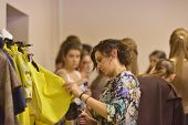NOVOSIBIRSK, RUSSIA - NOVEMBER 15, 2014: Staff prepares the collection of Elena Shipilova to the Novosibirsk Fashion Week. The event was held under the motto High Fashion & High Classics