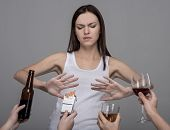 stock photo of  habits  - Portrait of a young woman who refuses to alcohol and tobacco - JPG
