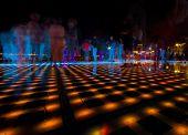 People walking on lighted floor