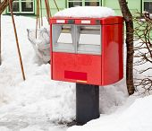 A Traditional Red Japanese Postbox At Winter Time Covered In Snow.