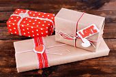Three gift boxes on wooden background