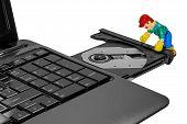 Toy Man Repairing A Laptop