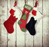 Christmas Stocking Against Rustic Wood