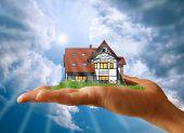 New House On A Hand Against The Sky