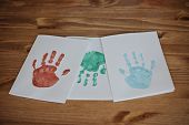 Kids handprints on white paper